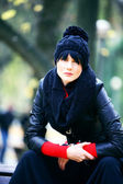 Young pretty woman in hat at the autumn park. — Stock Photo