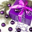 Purple gift box with christmas balls — Stock Photo