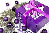 Purple gift box with christmas balls — Stock Photo