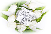 White tulips and gift box on a white background — Stock Photo