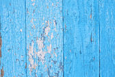 Cracked paint on a wooden surface. Grunge style background. — Stock Photo