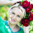 Woman in a wreath from roses — Stock Photo