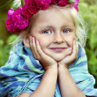 Portrait of little girl in a wreath from roses — Stock Photo #40227825