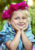 Portrait of little girl in a wreath from roses — Stock Photo