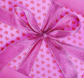 Gift box with heart pattern — Stock Photo