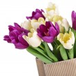 Bouquet from yellow and purple tulips in a paper package — Stock Photo #42477741