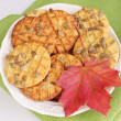 Cookies with sunflower seed and autumn red leaf — Stockfoto