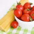 Ingredients: сherry tomatoes in a bowl and  spaghetti on green — Stock Photo #43108435