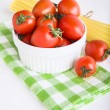 Ingredients: сherry tomatoes in a bowl and spaghetti — Stock Photo
