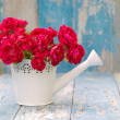 Bouquet of pink roses in white watering can — Stock Photo #50543023