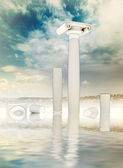 Fou ruined columns in Greek Ionian style in water — Stock Photo