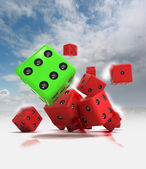 Group of ahead rolling red dices with one winning green — Stock Photo