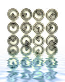 Steel metallic watches in water reflections — Stock Photo