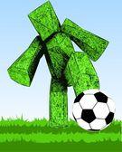 Gras abbildung stoppt fußball ball mit körper im feld — Stockfoto