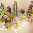 Stock Photo: Yellow alight skyscrapers business city design concept illustration