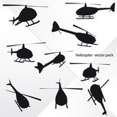 Isolated nine helicopter silhouettes at flight vector — Stock Vector