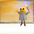 Pumpkin witch with magic wand on right side ahead of orange board template — Stock Photo