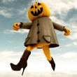 Running halloween pumpkin witch with blue sky illustration — Stock Photo