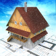 Mountain building house with layout plan at cloudy snowfall — Stock Photo #18281733