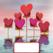 Metallic stand in water with pink red hearts card — Stock Photo #19280789