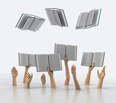 Arms catching flying books on white background — Stock Photo