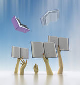 Arms catching flying books with blur sky — Stockfoto