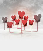 Stand with red hearts on cloudy black and white sky — Stock Photo
