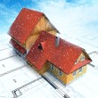 Classical mountain house with layout plan at cloudy snowfall — Stock Photo