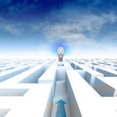 Labyrinth with arrow leading to bulb and blue cloudy sky — Stock Photo