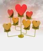Branch with golden and red hearts with cloudy sky — Stock Photo