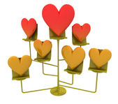 Metalic stand with golden and red hearts — Stock Photo