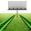 Two green railroads with blank billboard - Stock Photo