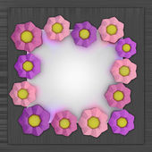 Big pink blossom square frame on metallic surface — Stock Photo