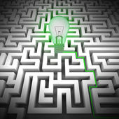 Green bulb shines above labyrinth — Stock Photo
