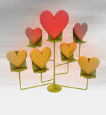 Rack with golden and red hearts blur background — Photo