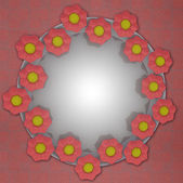 Blossom circle structure on red linen — Stock Photo