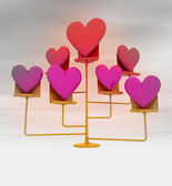 Golden stand with pink red hearts with background blur — Stock Photo
