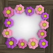 Big pink blossom square frame on wooden surface — Stock Photo