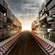 Stock Photo: Racetrack in evening light bussiness city
