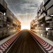 Racetrack in evening light bussiness city — Stock Photo #28330793