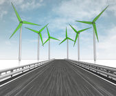 Windmill turbine field around motorway with sky — Stock Photo