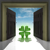 Green happy cloverleaf in doorway with sky — Stock Photo