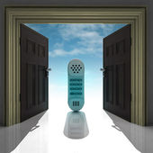 Retro hand phone in doorway with sky — Stock Photo