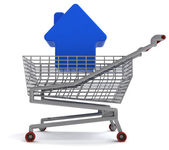 Fastigheter hus i shoping vagn på vit — Stockfoto