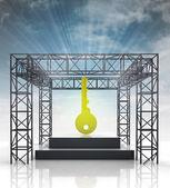 Show stage with golden key and sky flare — Stock Photo