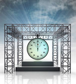 Show stage with shiny stopwatch and sky flare — Stock Photo
