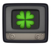 Isolated green cloverleaf in retro television — Stock Photo