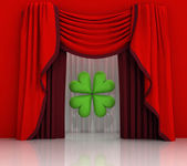 Red curtain scene with green cloverleaf — Stock Photo