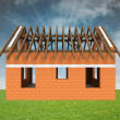 Bricked house construction in grass with sky flare — Stock Photo