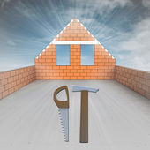 Attic house under construction with tools — Stock Photo
